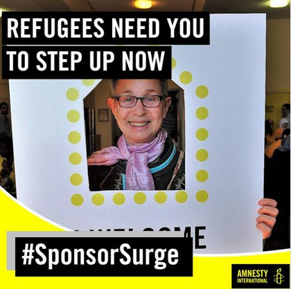 Woman holding a sign that reads I Welcome. Refugees need you to step up now #SponsorSurge.